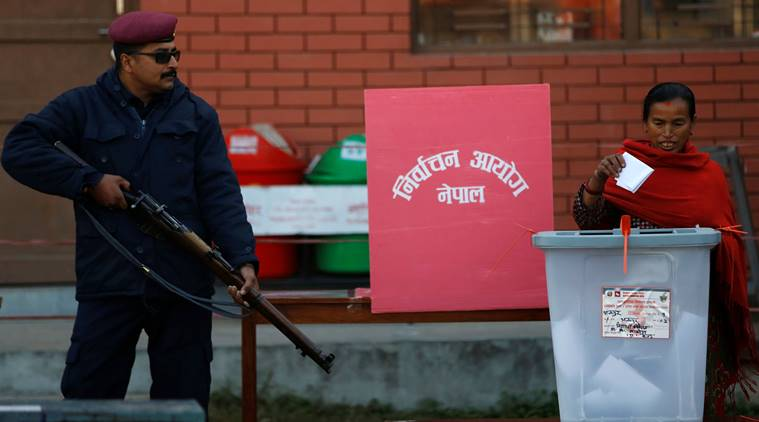 A woman casts her vote during the parliamentary and provincial elections in Bhaktapur, Nepal December 7, 2017. Credit: Reuters/Navesh Chitrakar