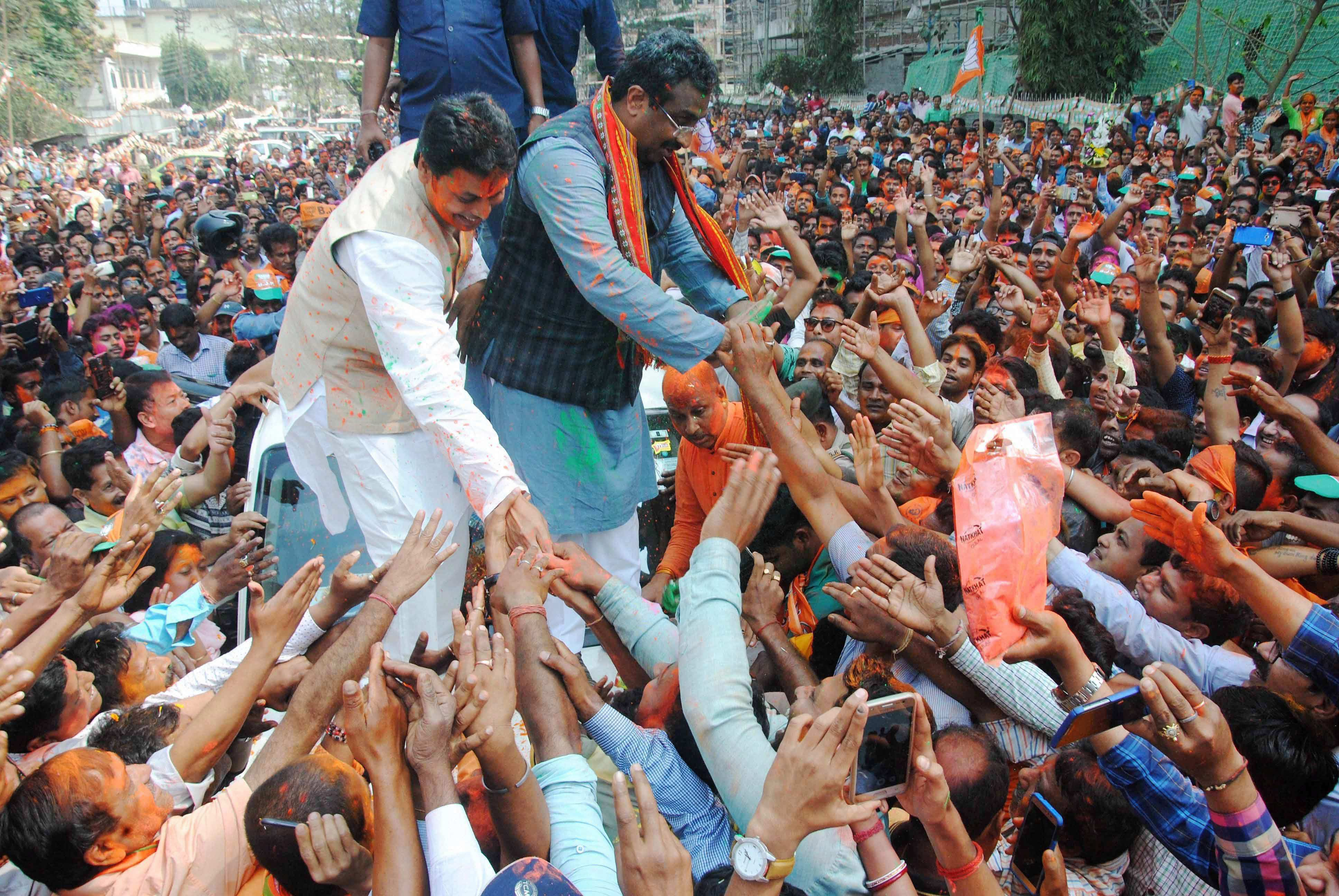 BJP national general secretary Ram Madhav and Tripura BJP chief Biplab Kumar Deb greet the supporters after party's victory in Tripura assembly elections in Agartala on Saturday. BJP's win marks an end to 25 years of CPI(M) rule in the state. Credit: PTI