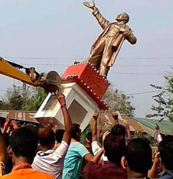 BJP cadres bringing down a statue of Lenin in Belonia town in Tripura. Credit: Twitter
