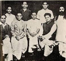 Group photo of Hindu Mahasabha. Standing - Shankar Kistaiya, Gopal Godse, Madanlal Pahwa, Digambar Badge. Seated - Narayan Apte, Vinayak D. Savarkar, Nathuram Godse, Vishnu Karkare. Credit: Flickr