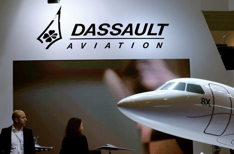 A Dassault Aviation logo is pictured on the company booth during the European Business Aviation Convention & Exhibition (EBACE) at Cointrin airport in Geneva, Switzerland, May 24, 2016. Credit: Reuters/Denis Balibouse/Files
