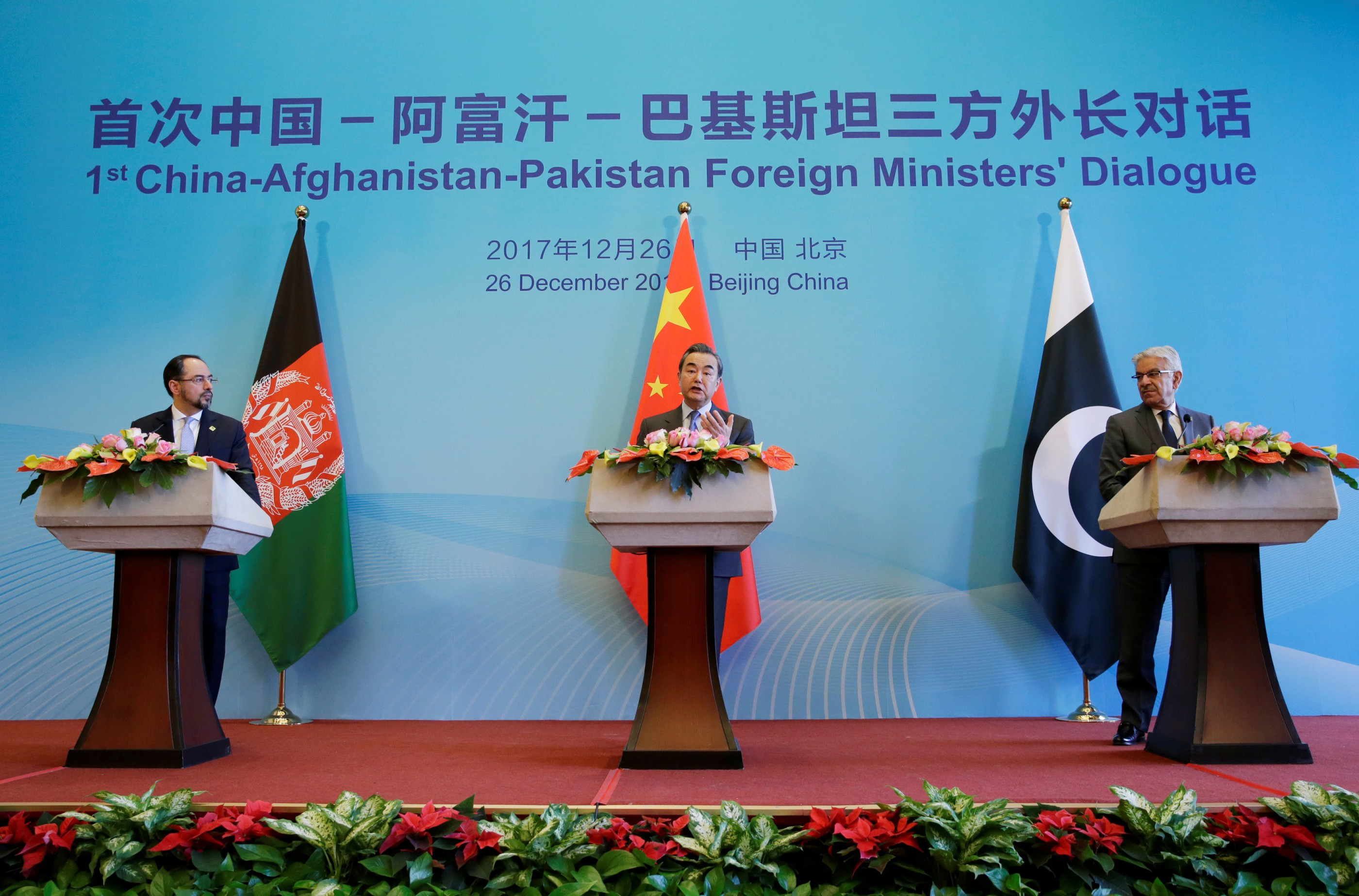 (L to R) Afghan Foreign Minister Salahuddin Rabbani, Chinese Foreign Minister Wang Yi and Pakistani Foreign Minister Khawaja Asif attend a joint news conference after the 1st China-Afghanistan-Pakistan Foreign Ministers' Dialogue in Beijing, China, December 26, 2017. Credit: Reuters /Jason Lee