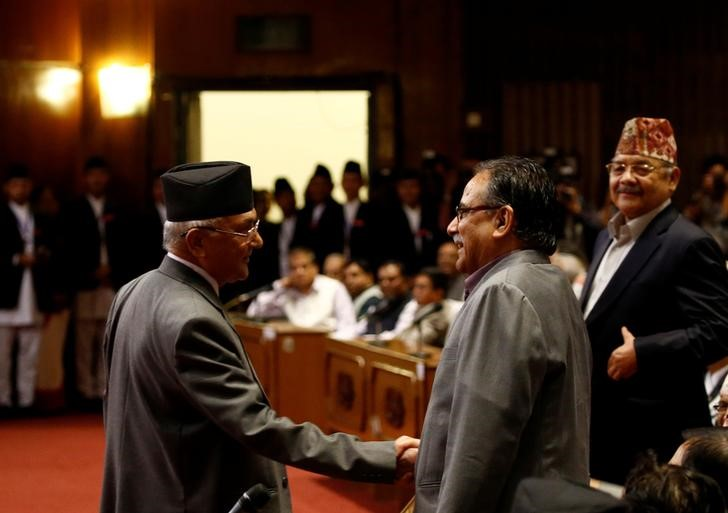 Nepal's Prime Minister KP Oli shakes hand with Chairman of the Unified Communist Party of Nepal (Maoist) Pushpa Kamal Dahal. Credit: Reuters/Navesh Chitrakar