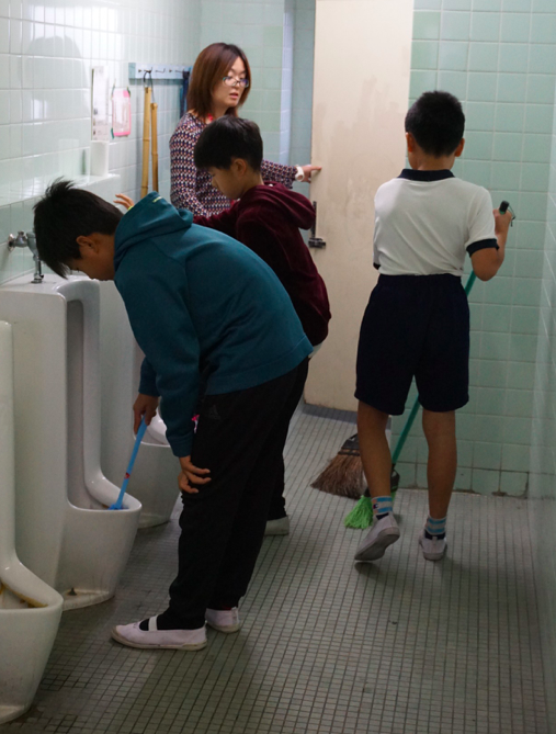 Boys cleaning a toilet at Kita-Yamada Elementary School in Osaka. Credit: Janaki Nair