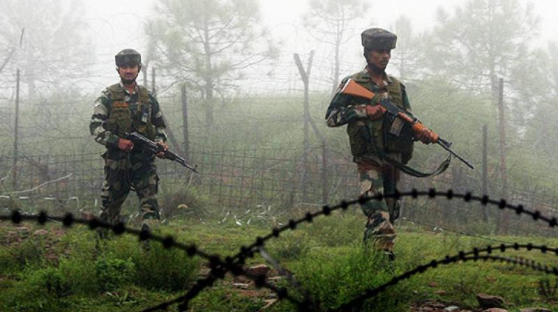 Indian army personnel walking along the India Myanmar border. Credit: PTI