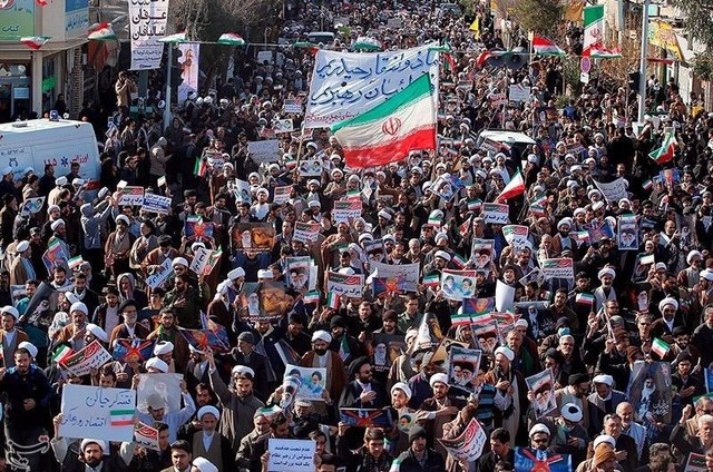 People take part in pro-government rallies, Iran, January 3, 2018. Tasnim News Agency/Handout via Reuters