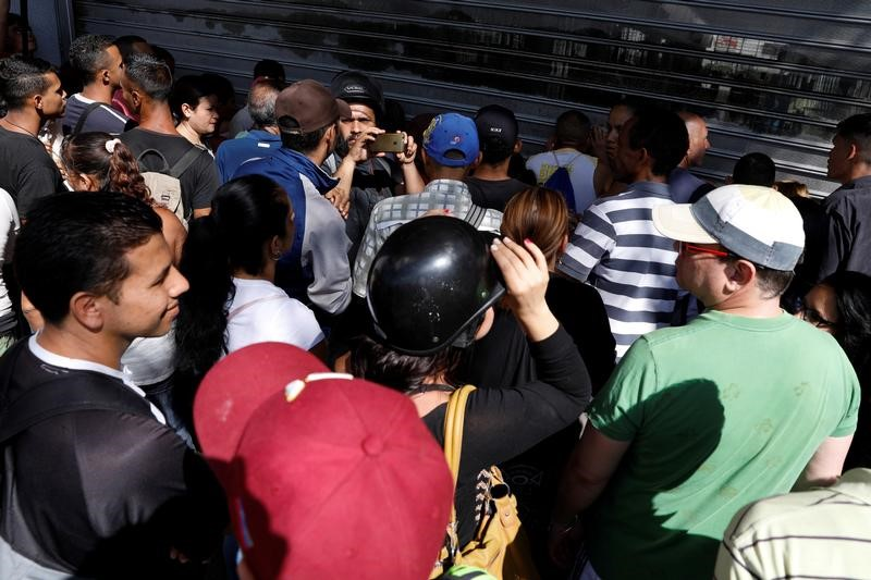 Venezuela's Maduro Forced Price Cuts Gets Caracas Shops Mobbed