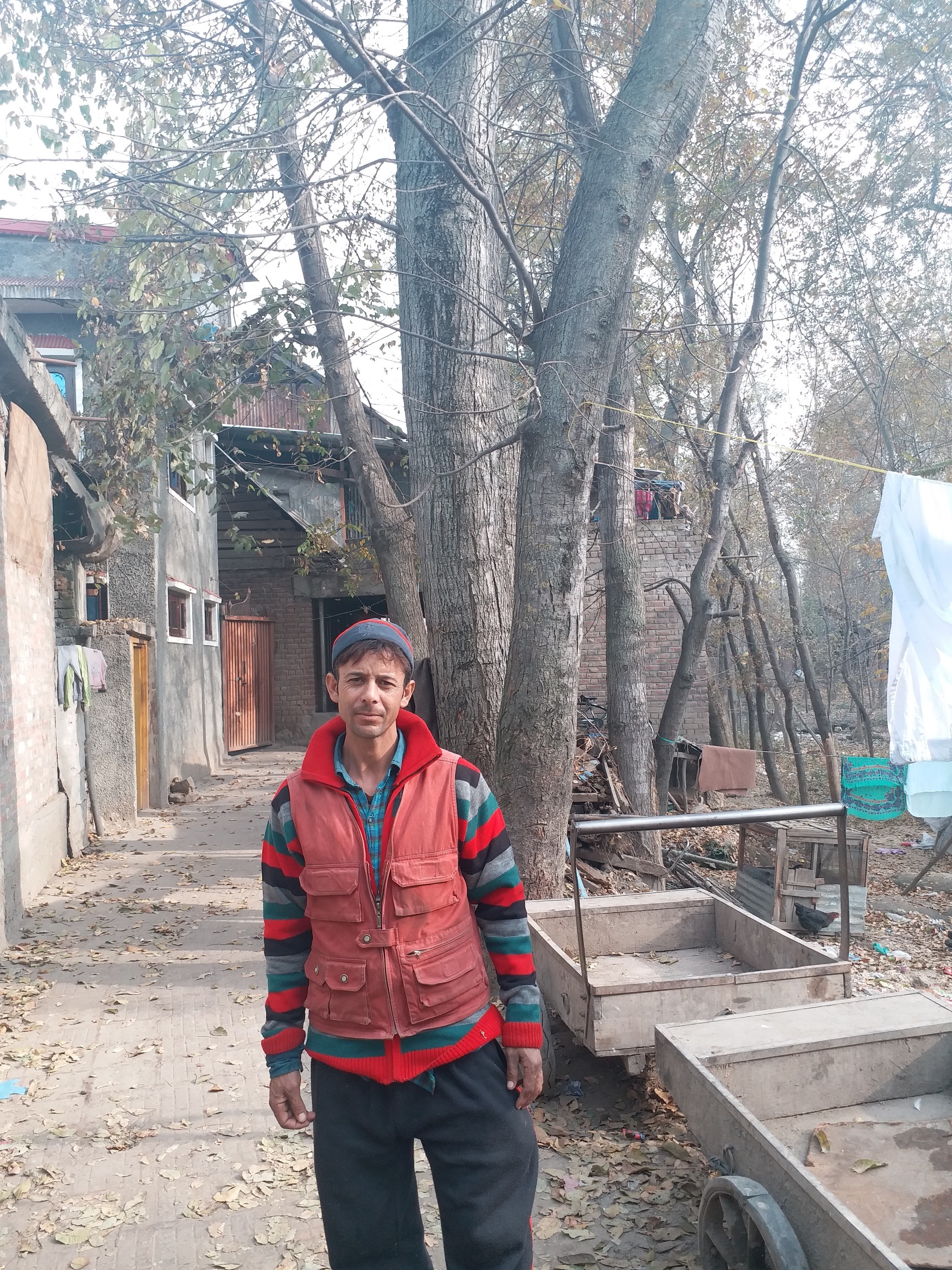Abdul Rashid Sheikh, father of pellet victim Asif, outside his house at Khanabal, Anantnag in Jammu and Kashmir. Credit: Anando Bhakto