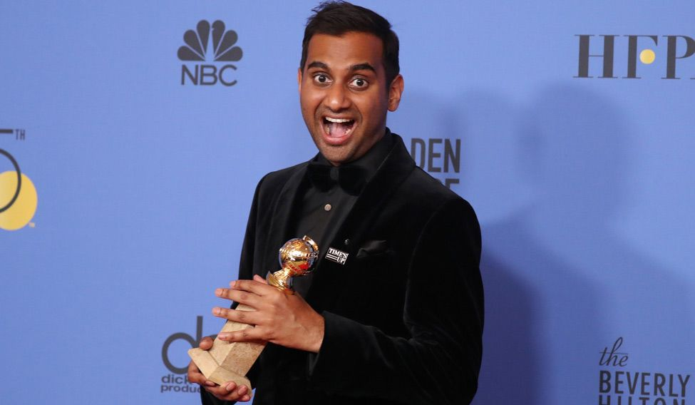 Aziz Ansari wearing a 'Times Up' pin at the Golden Globe Awards. Credit: Reuters