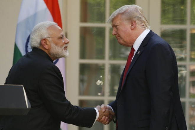 US President Donald Trump (R) greets Indian Prime Minister Narendra Modi. Credit: Reuters/Kevin Lamarque