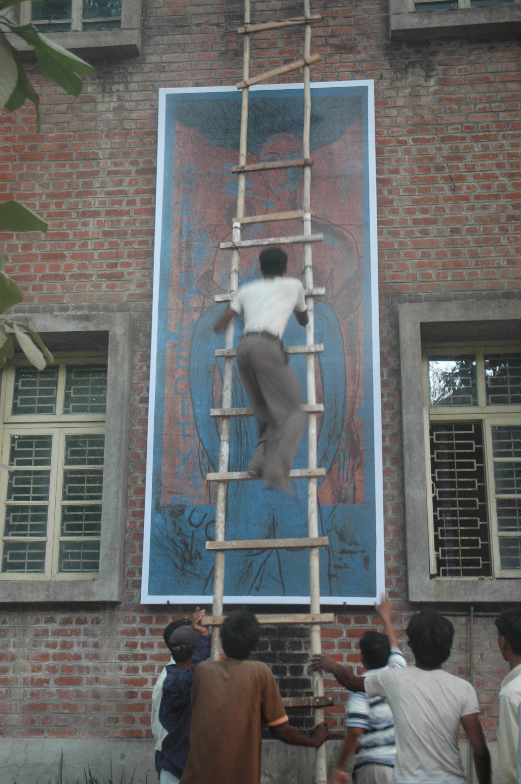Government officials bringing down Chandramohan's art at the Faculty of Fine Arts, Vadodara, May 11, 2007. Image courtesy: Students of the Faculty of Fine Arts. Source: Akansha Rastogi and B.V. Suresh