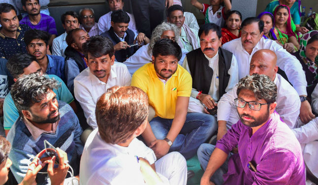 Jignesh Mevani, Hardik Patel and Alpesh Thakor meet relatives of Dalit activist Bhanubhai Vankar. Credit: PTI