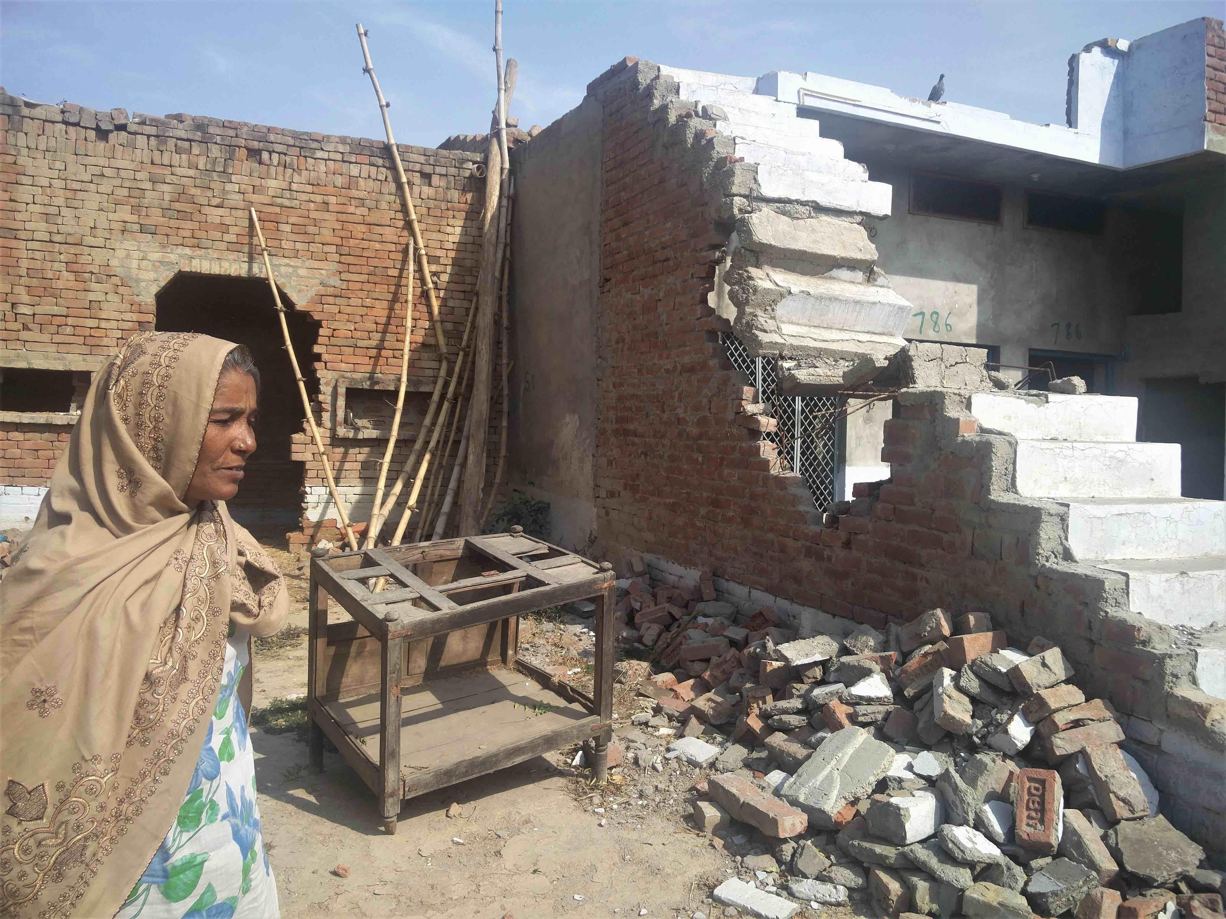 Meena, Vasim's mother, in her house broken down by the cops. Credit: Neha Dixit