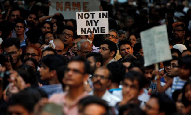 Protests against the recent wave of attacks on Muslims by mobs that accuse them of killing cows or eating beef. Credit: Reuters