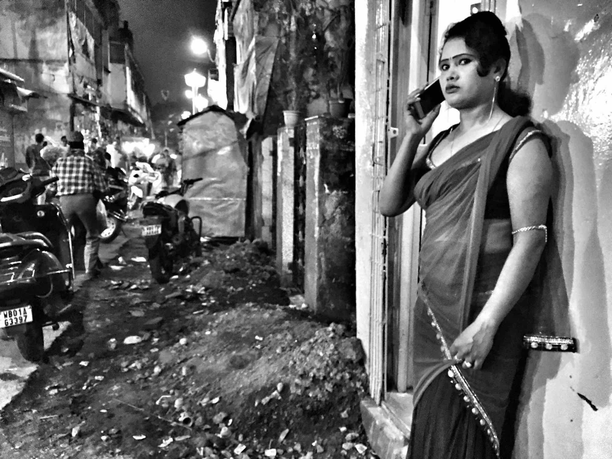 A girl waits along the by lanes of Sonagachi for clients.