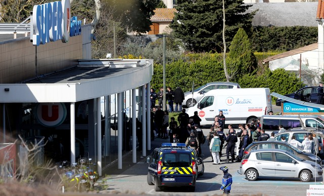 French Police Officer Who Took Place of Hostage Dies