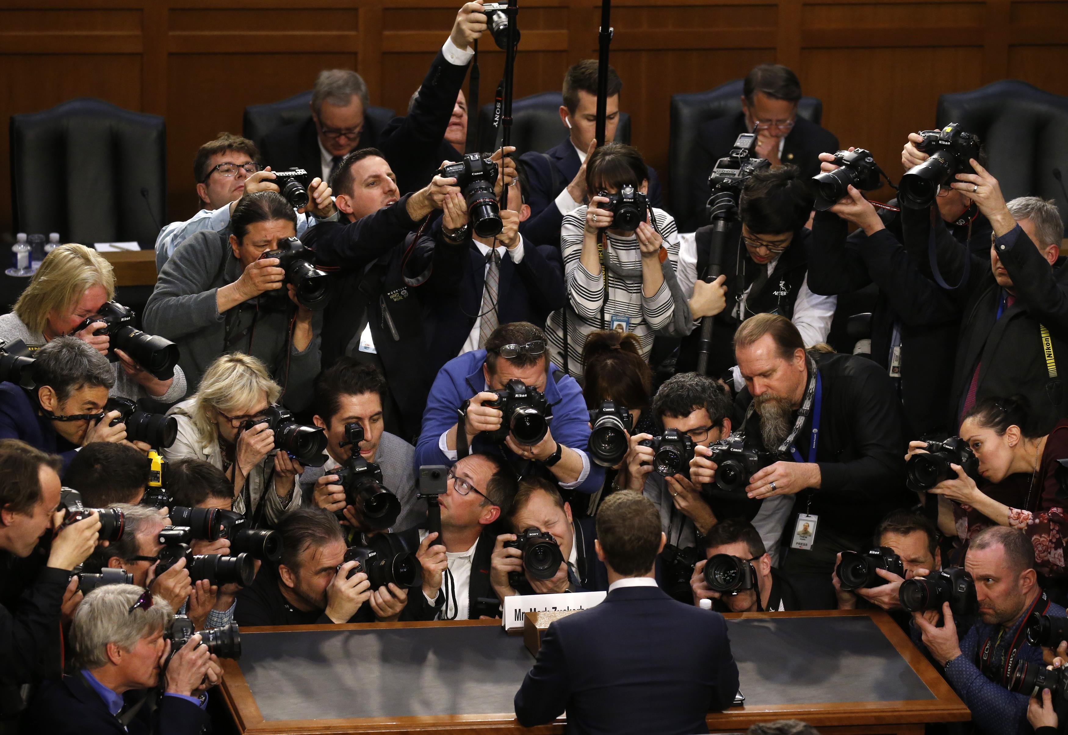 Facebook CEO Mark Zuckerberg is surrounded by members of the media as he arrives to testify before a Senate Judiciary and Commerce Committees joint hearing regarding the company's use and protection of user data, on Capitol Hill in Washington, US, April 10, 2018. Credit: Reuters/Leah Millis