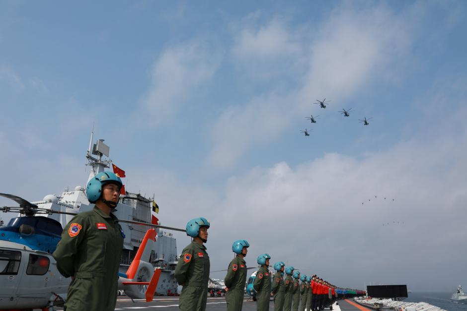 Navy personnel of Chinese People's Liberation Army (PLA) Navy take part in a military display in the South China Sea April 12, 2018. Picture taken April 12, 2018. Credit: Reuters/Stringer