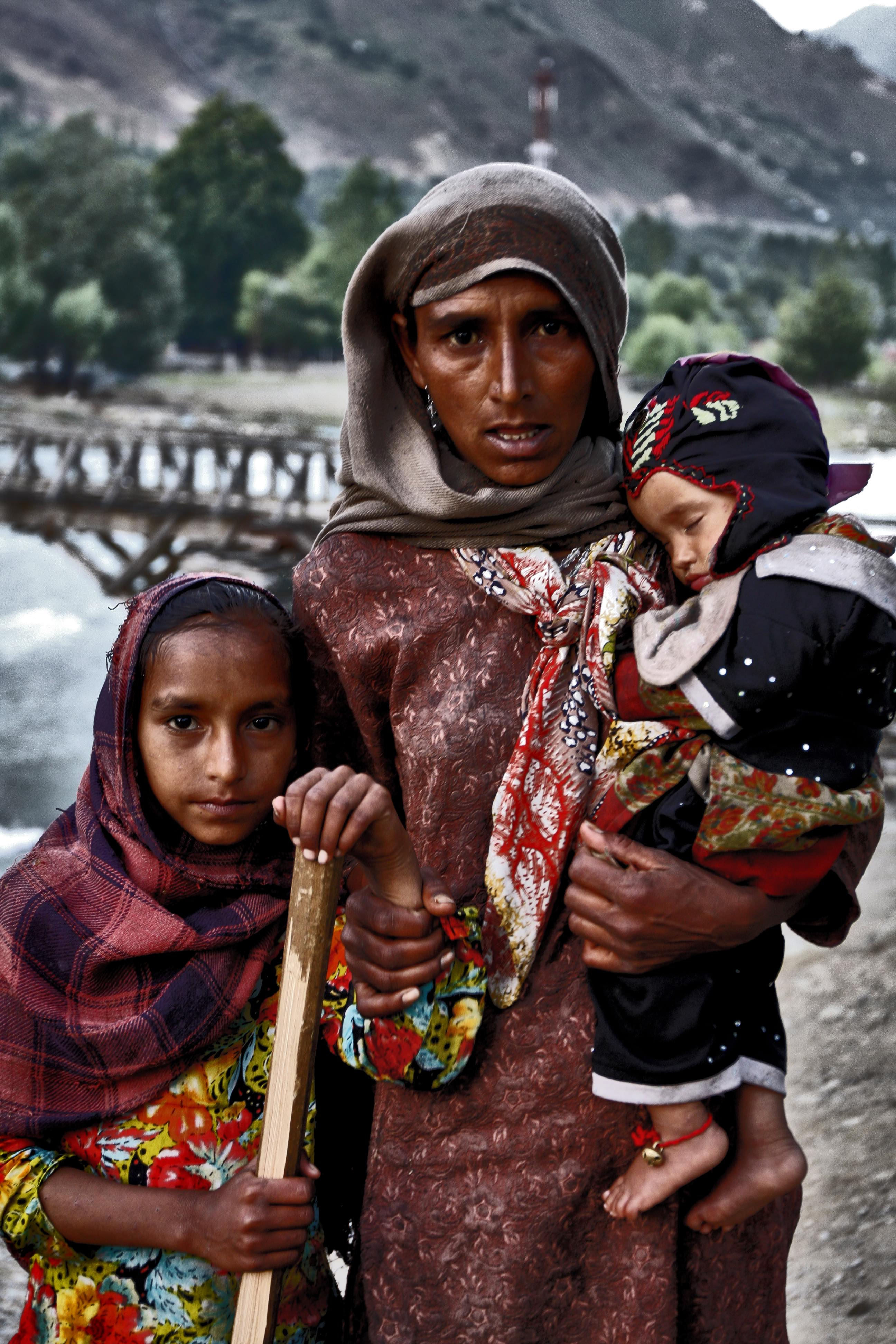 A Bakarwal woman with her daighter and son.