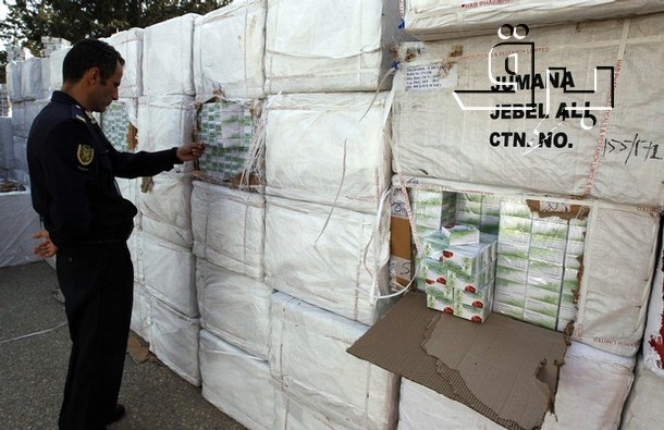 A Libyan police officer views a haul of prescription drug Tramadol seized from a shipping container in Tripoli March 3, 2011. Caption and credit: brqnetwork/Flickr, CC BY 2.0