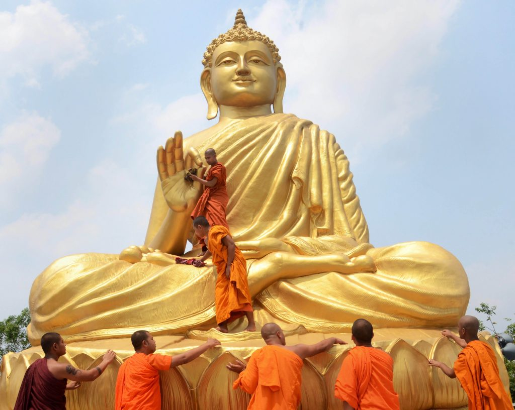 Buddhists monks clean a statue of Lord Buddha ahead of Buddha Purnima festival in Howrah on Wednesday. Credit: PTI