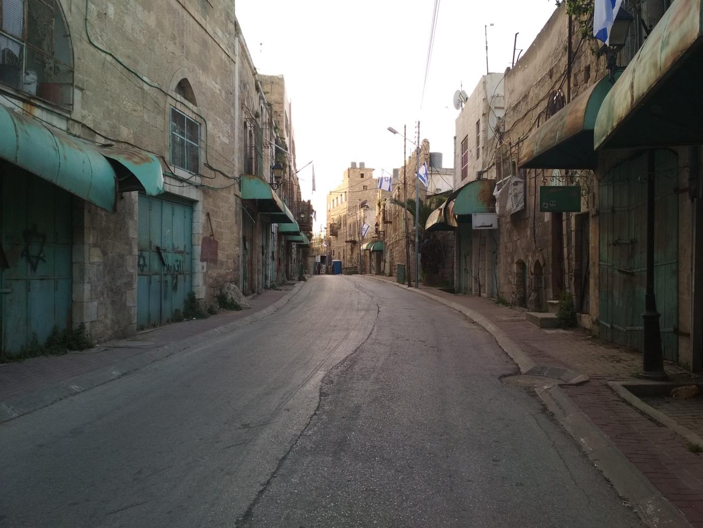 A part of Shuhada street in Hebron's Old City wears a ghost-town look since it is now forbidden for Palestinians to go there. It is open to Israeli Jews and foreigners.