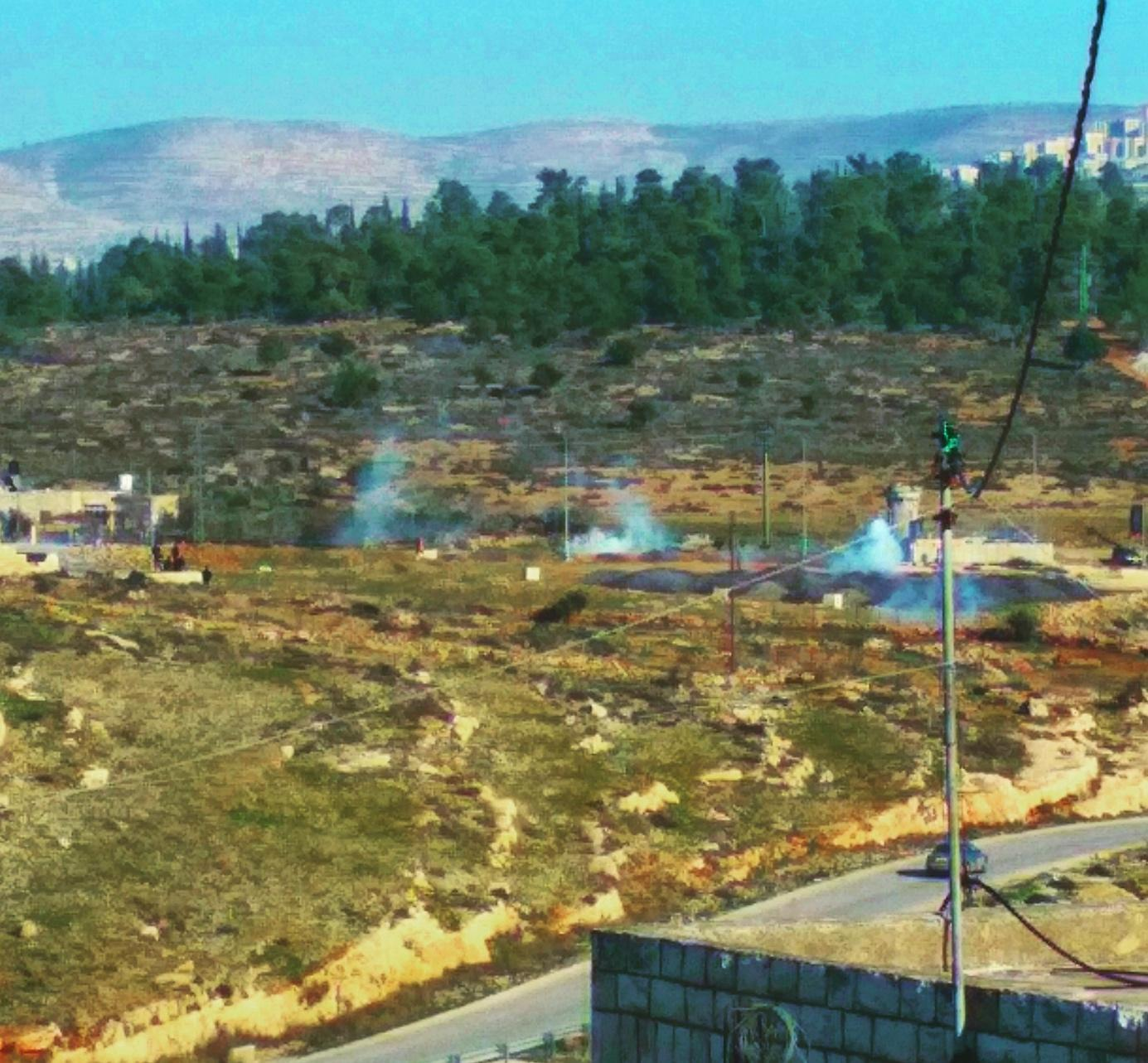 Usual scenes in the village of Nabi Saleh: A sniper tower at the entrance to the village and frequent tear gassing by Israeli soldiers.