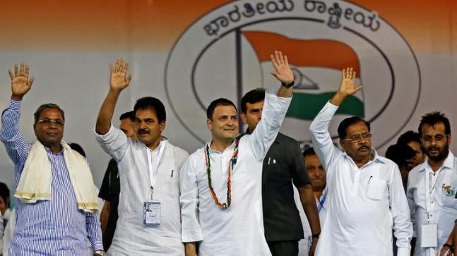 Rahul Gandhi (centre) waves to the crowd before addressing an election campaign rally ahead of the Karnataka state assembly elections. Credit: Reuters
