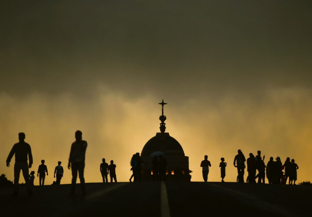 Silhouttes of people enjoying the pleasant weather, at Raisina Hills in New Delhi on Sunday. Credit: PTI Photo/Ravi Choudhary