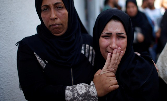 Israeli Forces Kill Two Palestinians Near Border as Gaza Buries 60 Bodies