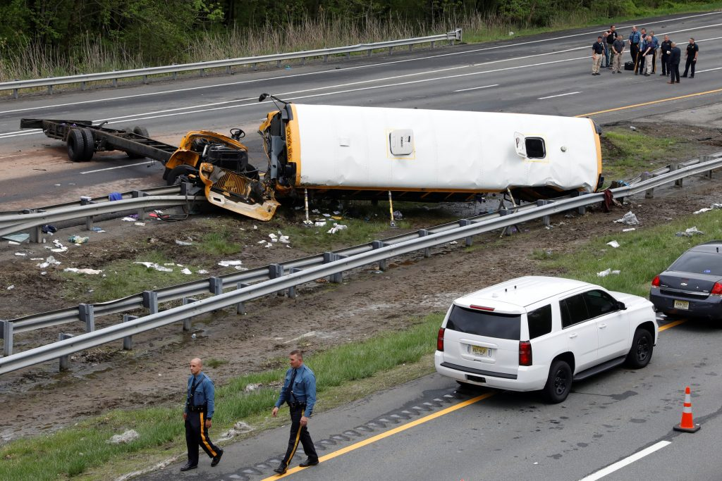 School bus hits dump truck on NJ highway; 2 dead