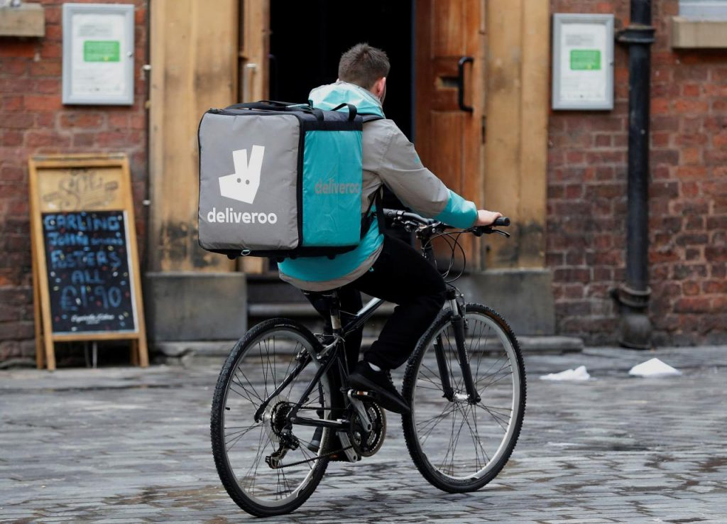 A deliveroo worker cycles along a pedestrianised road in Liverpool, Britain, October 18, 2017. Credit: Reuters/Phil Noble