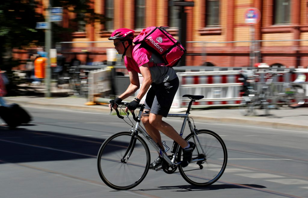 Andreas Harte, a Foodora delivery cyclist poses on a street in Berlin, Germany, June 2, 2017. Credit: Reuters/Fabrizio Bensch