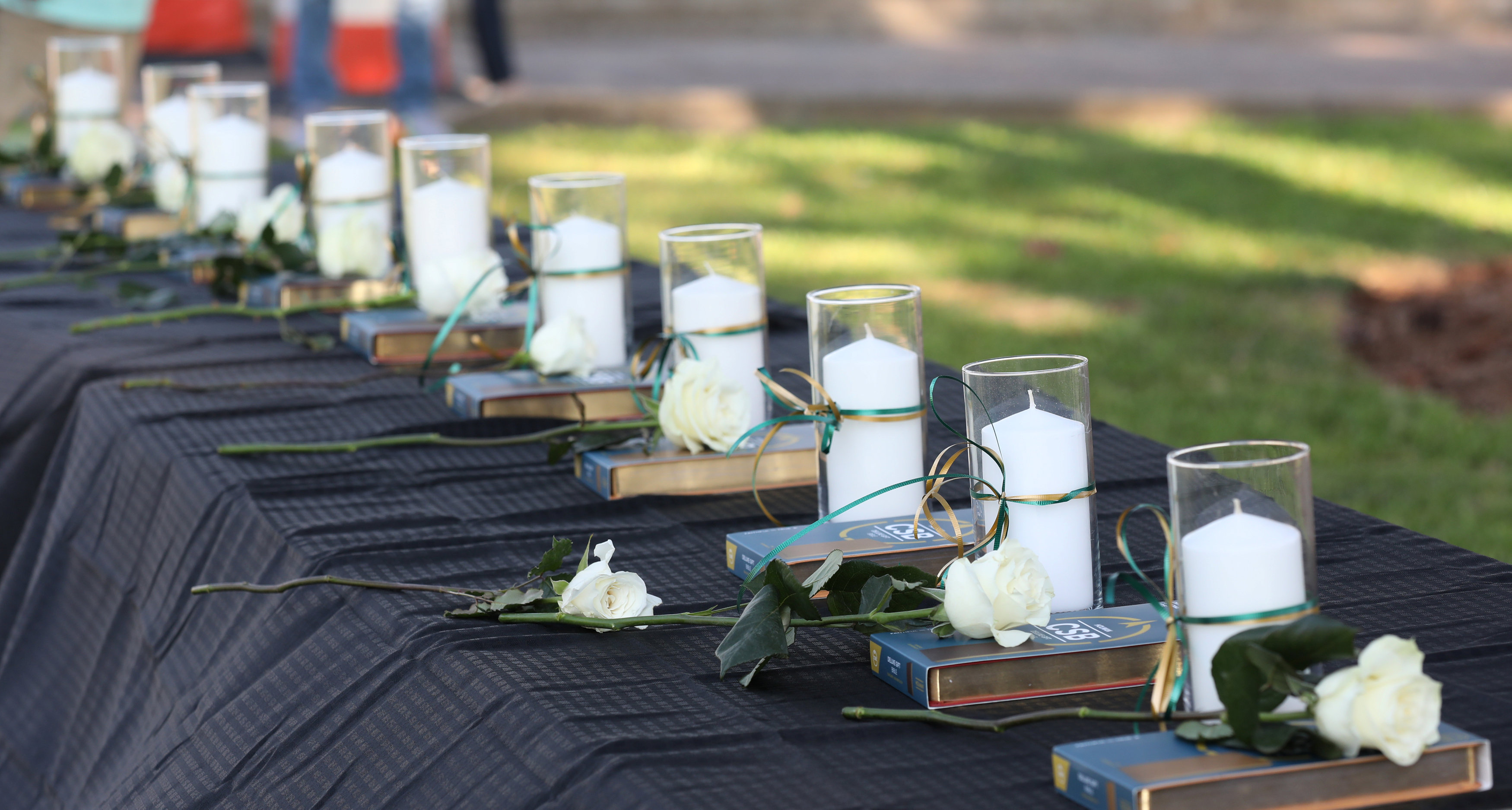 Candles line a table during a vigil held at the Texas First Bank after a shooting left several people dead at Santa Fe High School in Santa Fe Texas U.S