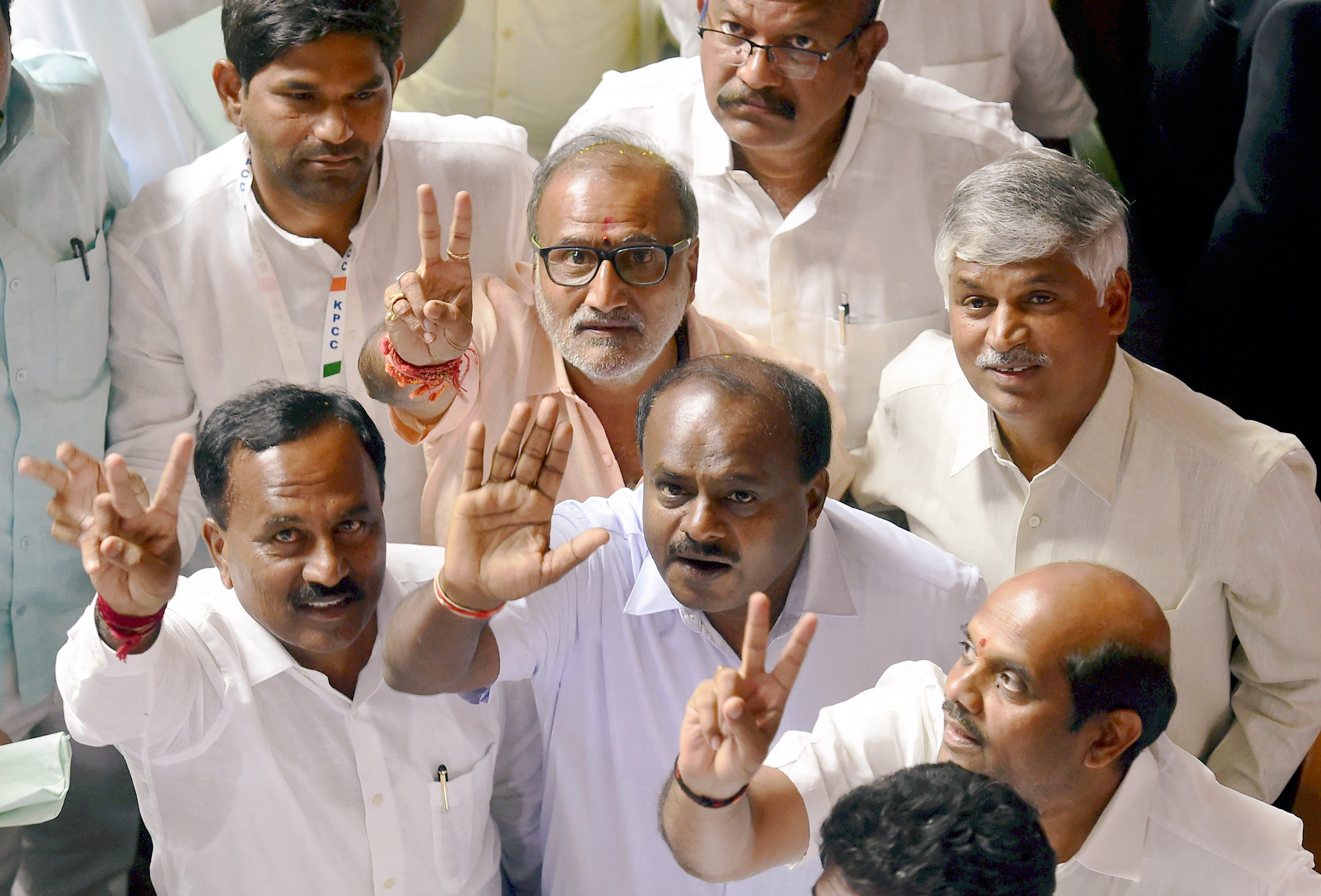 JD(S) leader H.D. Kumaraswamy and party MLAs after B.S. Yeddyurappa announced his resignation before the floor test, at Vidhana Soudha, in Bengaluru, on Saturday. Credit: PTI/Shailendra Bhojak