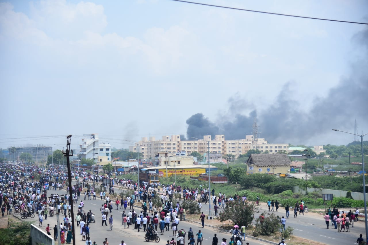 Smoke billows over Thoothukudi after protests demanding the closure of Vedanta's Sterlite Copper unit entered the 100th day on May 22, 2018. Credit: Surya, Tuticorin