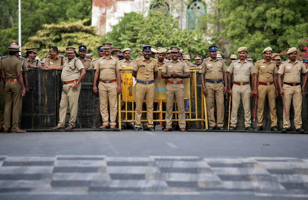 Policemen stand guard ahead of a protest, after at least 13 people were killed when police fired on protesters seeking closure of plant on environmental grounds in town of Thoothukudi in southern state of Tamil Nadu, in Chennai, India, May 24, 2018. Credits: REUTERS/P.Ravikumar