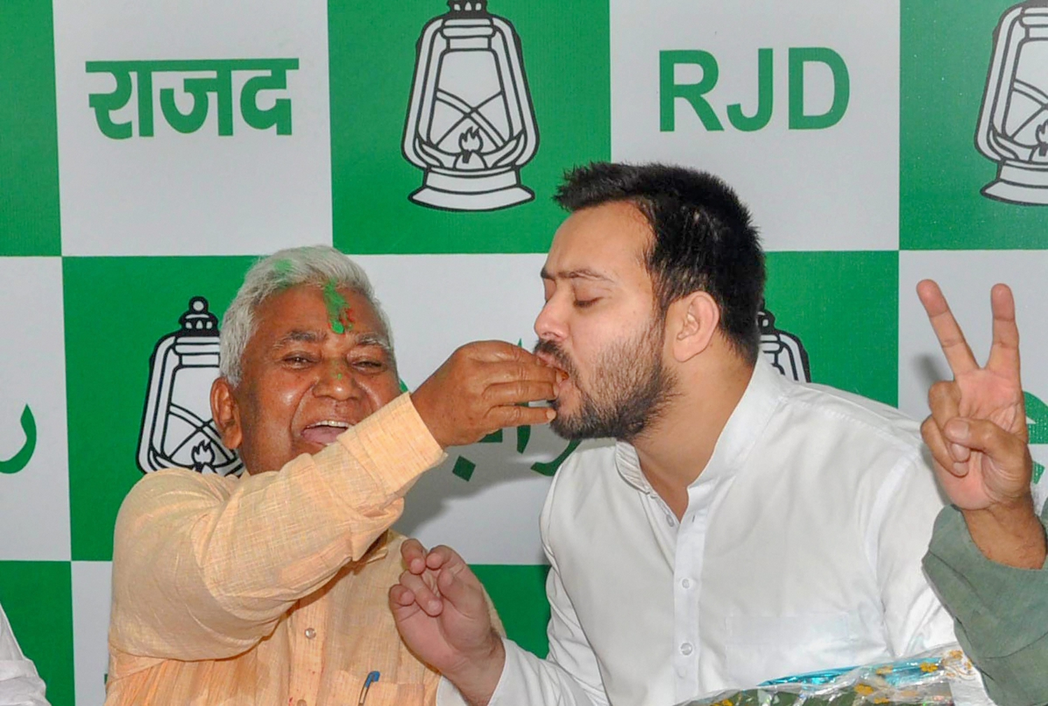 RJD leader Tejashwi Yadav is offered sweets by RJD state president Ramchandra Purbey to celebrate party's win in Jokihat Assembly by-election seat, in Patna on Thursday, May 31, 2018. Credit: PTI