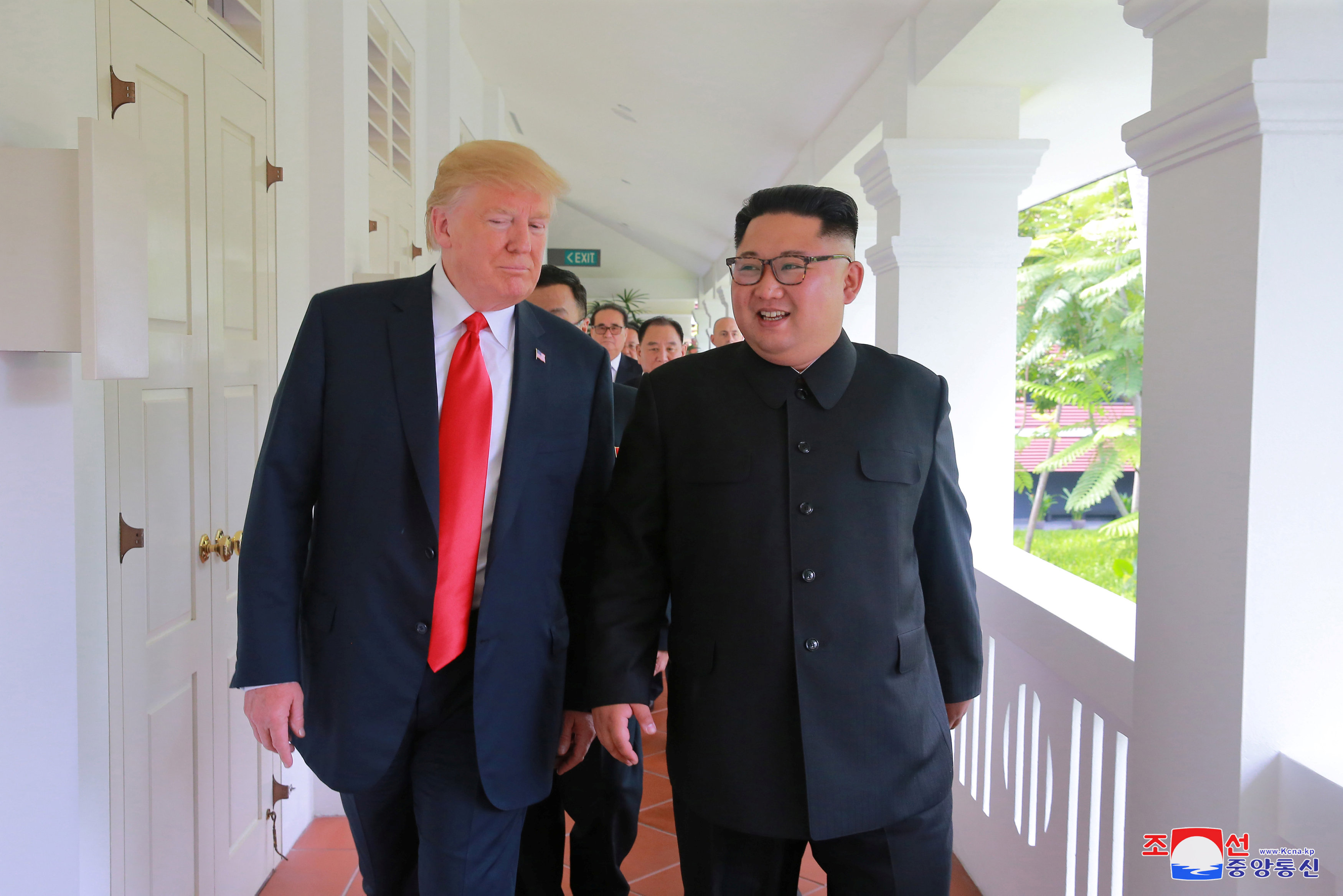 US President Donald Trump walks with North Korean leader Kim Jong Un at the Capella Hotel on Sentosa island in Singapore in this picture released on June 12, 2018 by North Korea's Korean Central News Agency. Credit: KCNA via Reuters