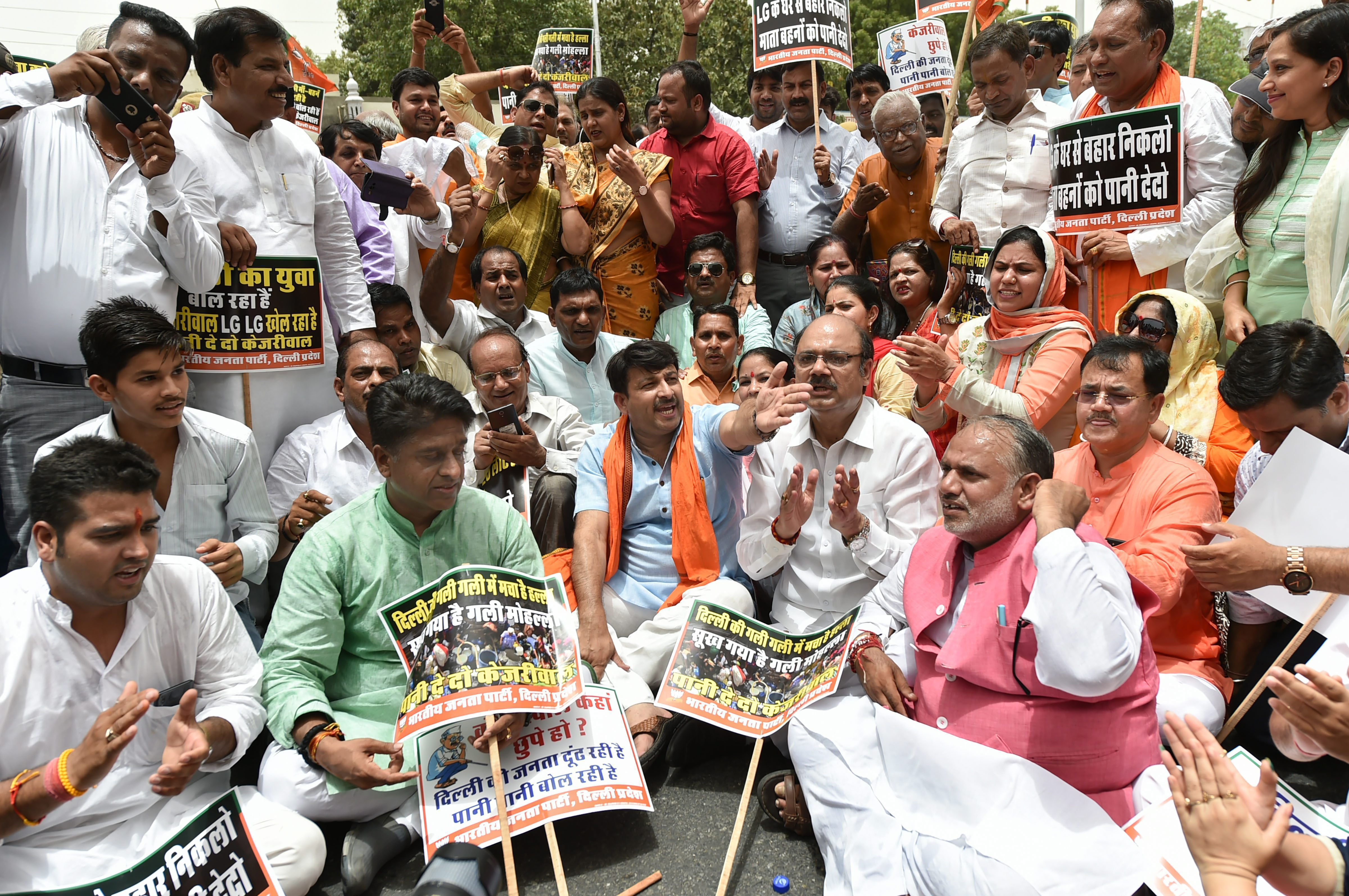 Delhi BJP president Manoj Tiwari with party workers raise slogans demanding water-power supply as they march towards Delhi chief minister Arvind Kejriwal's office, in New Delhi on Wednesday, June 13, 2018. Credit: PTI/Arun Sharma