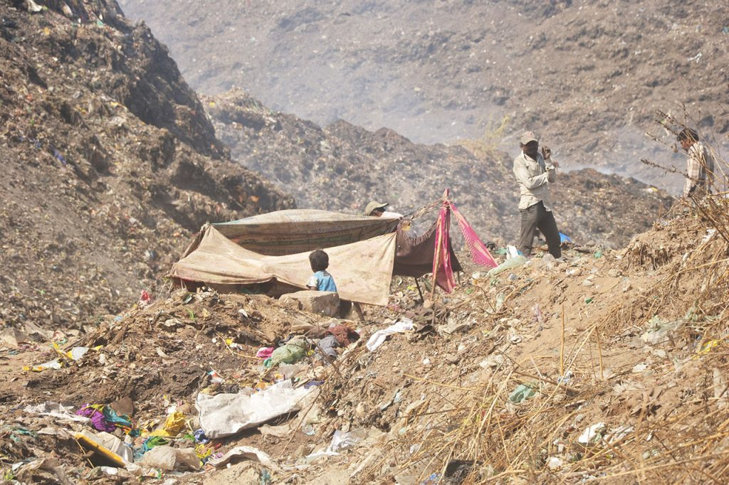 Under Ahmedabad's Mounting Garbage, It's the Migrant Worker Who Is Crumbling