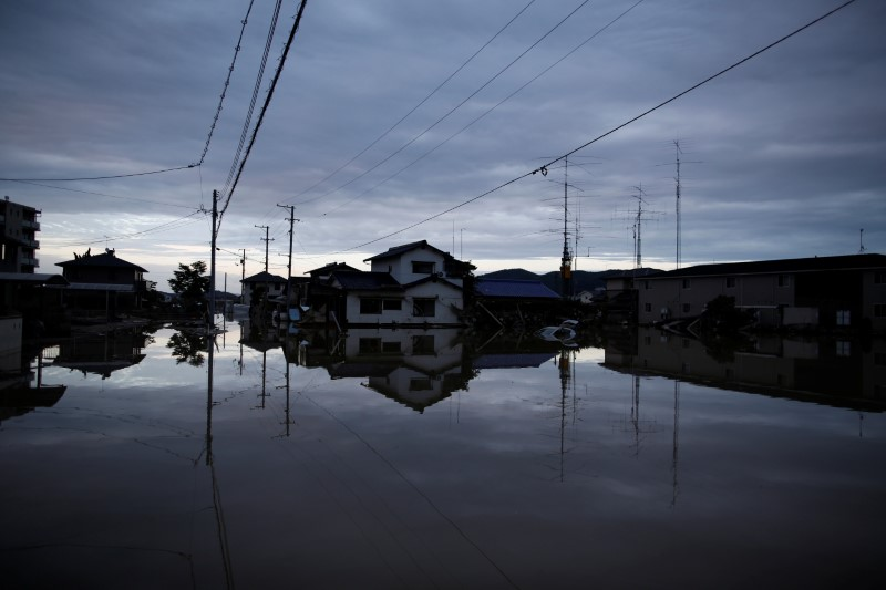 Submerged houses are seen in a flooded area in Mabi town in Kurashiki, Okayama Prefecture, Japan, July 8, 2018. Credit: Reuters/Issei Kato