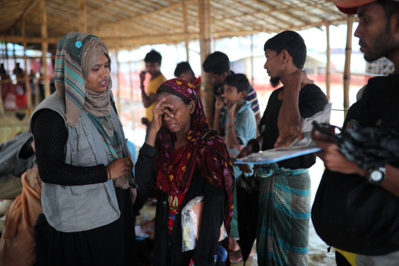 Jamila Khatu, a Rohingya refugee, breaks into tears as her son in Malaysia has been traceless for eight years, at designated point of Bangladesh Red Crescent Society, at Kutupalong camp in Cox's Bazar, Bangladesh, July 4, 2018. Credit: Reuters/Mohammad Ponir Hossain