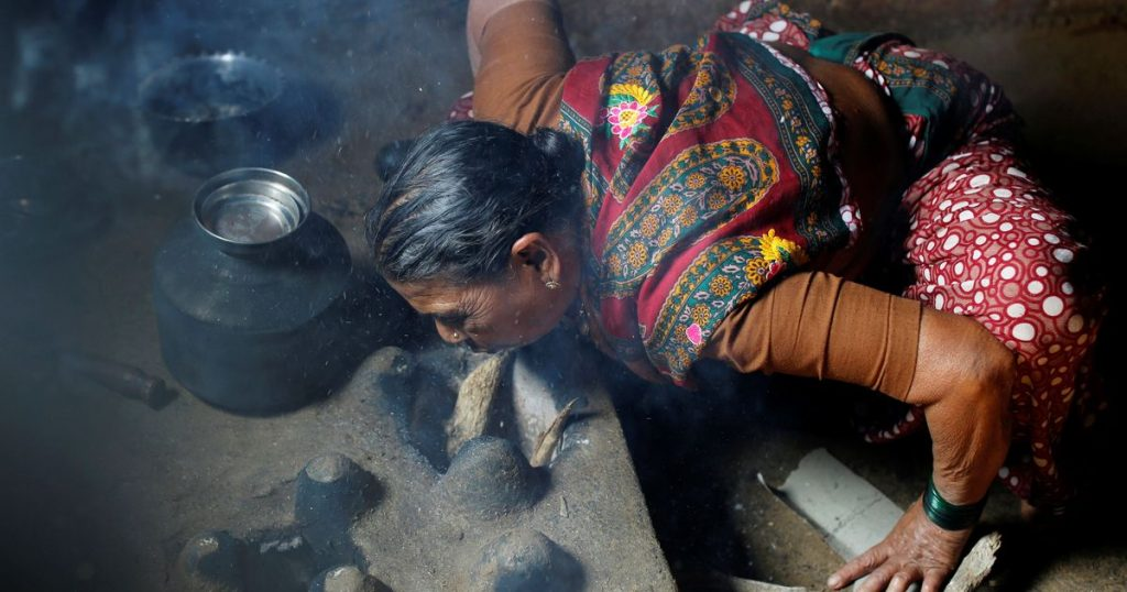 Using firewood to cook causes pollution and effects young children adversely. Credit Danish Siddiqui  Reuters