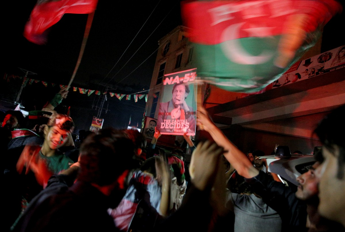 Supporters of Imran Khan, chairman of the Pakistan Tehreek-e-Insaf political party, celebrate near his residence in Bani Gala during the general election, in Islamabad, Pakistan July 25, 2018. Credit: Reuters/Athit Perawongmetha