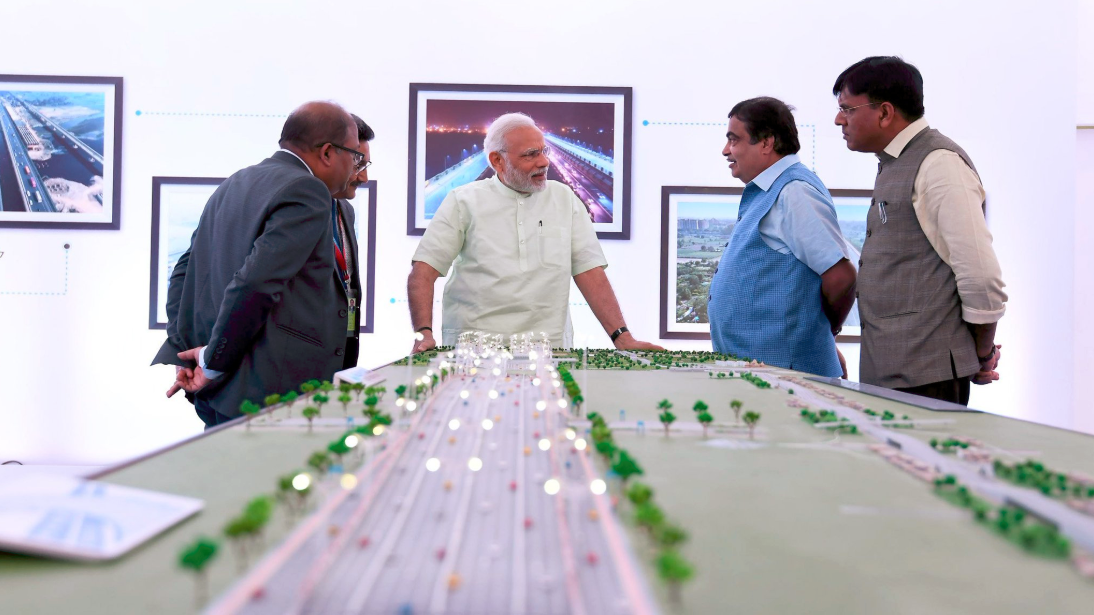 Narendra Modi visiting the exhibition to review progress of Delhi-Meerut Expressway, in Delhi. Union Minister for Road Transport Nitin Gadkari and MoS for Road Transport & Highways, Mansukh Mandviya are also seen. Credit: Twitter/MIB_India
