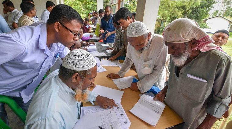 People check their names on the final draft of the state's National Register of Citizens after it was released, at a NRC Seva Kendra in Nagaon on Monday, July 30, 2018. Credit: PTI