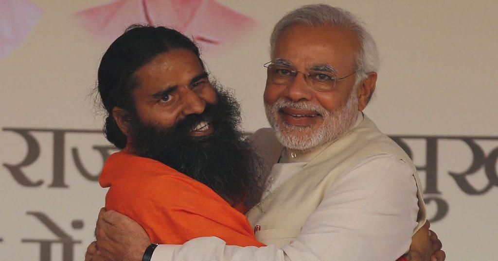 Prime Minister Narendra Modi and Ramdev hugging. Credit: Reuters/Adnan Abidi