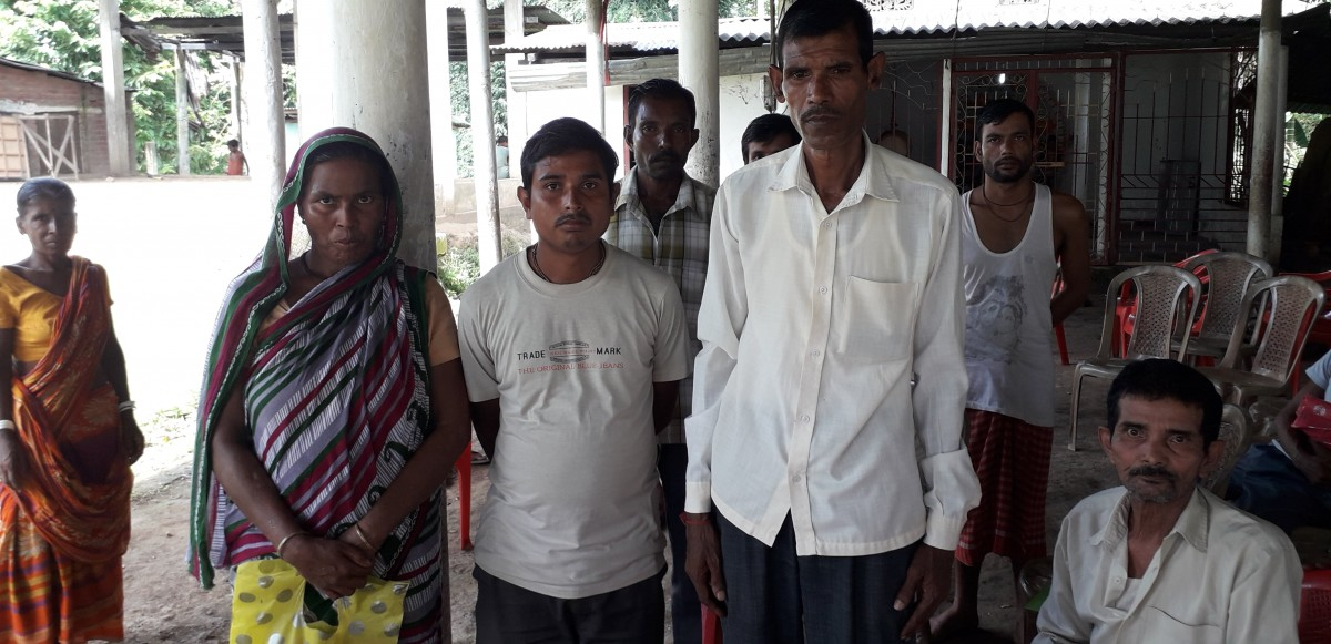 Basanti Das (L) standing with other villagers whose names were also left out of the final draft NRC in Pub Moirabari.