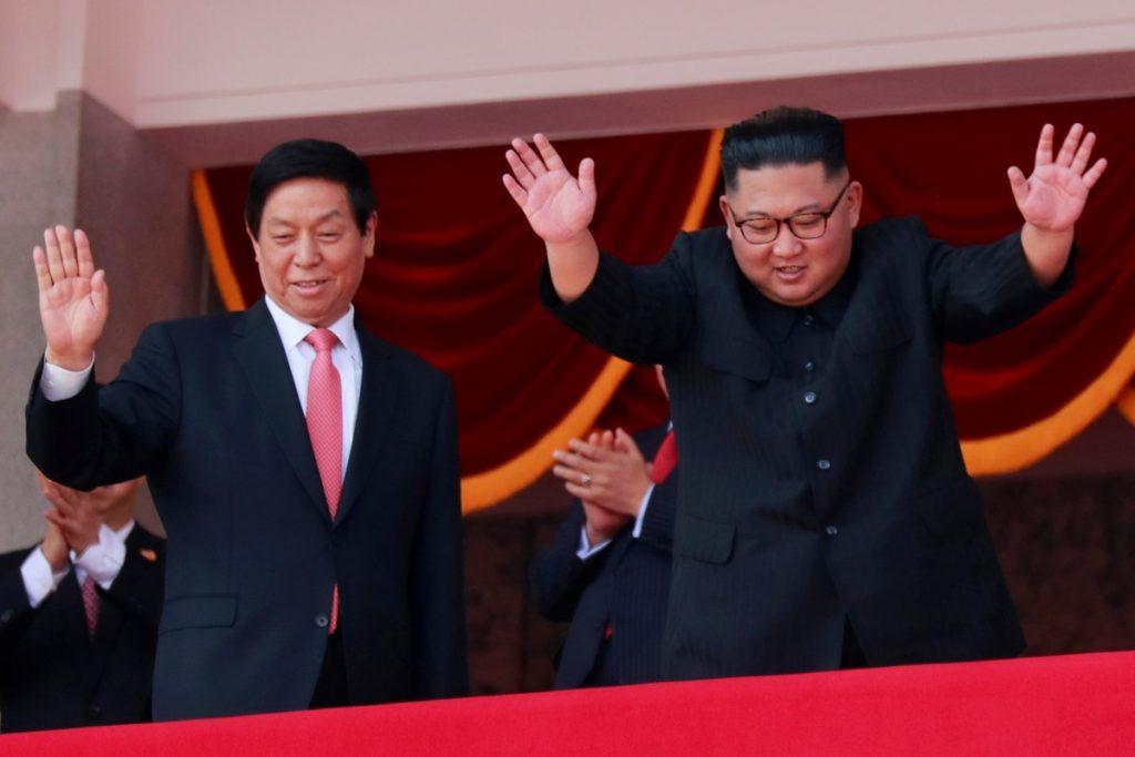 North Korean leader Kim Jong Un and China's Li Zhanshu, chairman of the Standing Committee of the National People's Congress (NPC), wave while attending a military parade marking the 70th anniversary of North Korea's foundation in Pyongyang, North Korea, September 9, 2018. Credits: Reuters/Danish Siddiqui
